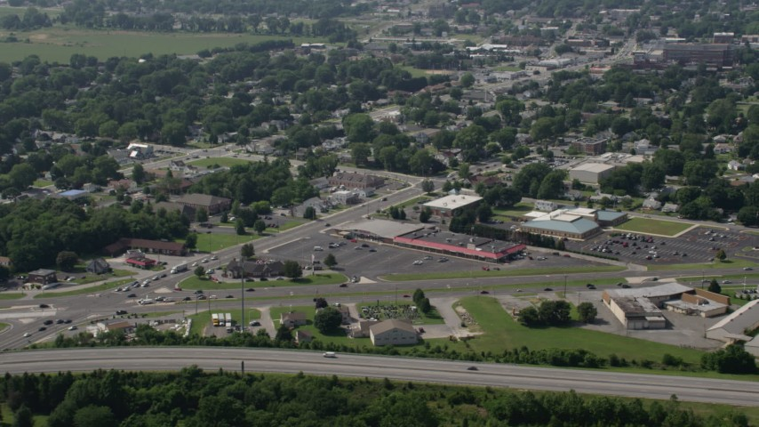 5K stock footage aerial video of strip malls and shops by Dupont Highway in Dover, Delaware Aerial Stock Footage | AX72_067