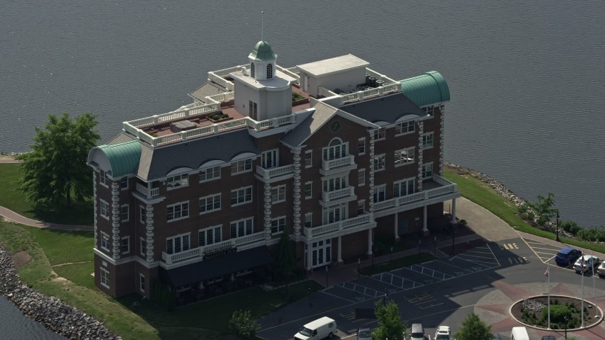 5K stock footage aerial video of Compass Pointe office building and Silver Lake in Dover, Delaware Aerial Stock Footage   AX72_072E