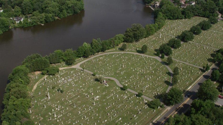 5K stock footage aerial video of Lakeside Cemetery by Silver Lake in Dover, Delaware Aerial Stock Footage | AX72_076