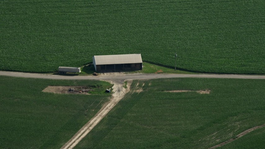 5K aerial video of a barn next to a crop field in Ingleside, Maryland Aerial Stock Footage | AX72_102
