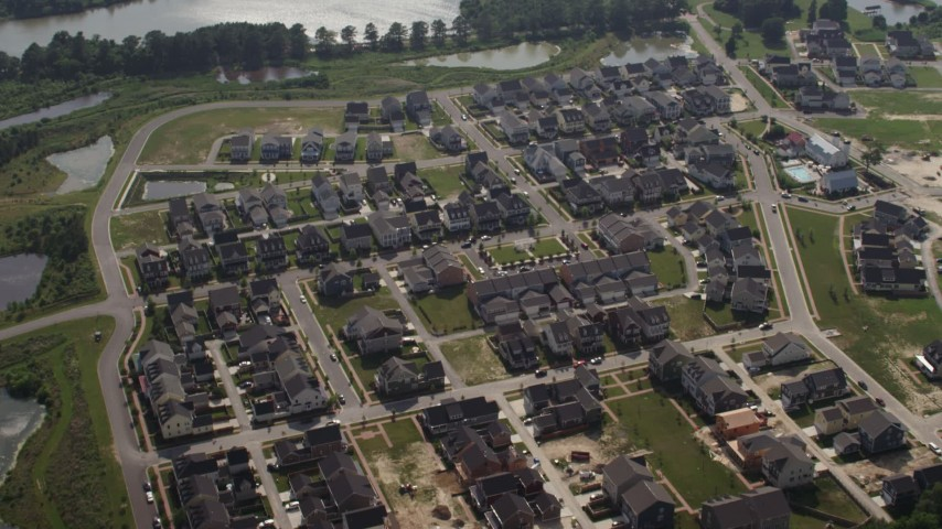 5K aerial video approaching a suburban neighborhood in Chester, Maryland Aerial Stock Footage | AX72_123