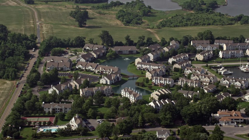 5K aerial video of condominiums around a pond in Chester, Maryland Aerial Stock Footage | AX72_125