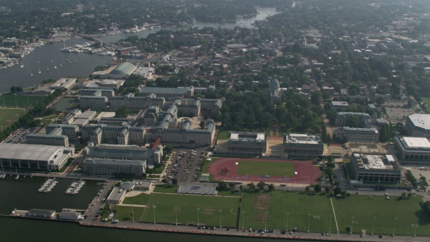 5K stock footage aerial video of the United States Naval Academy and Ingram Field in Annapolis, Maryland Aerial Stock Footage | AX73_009