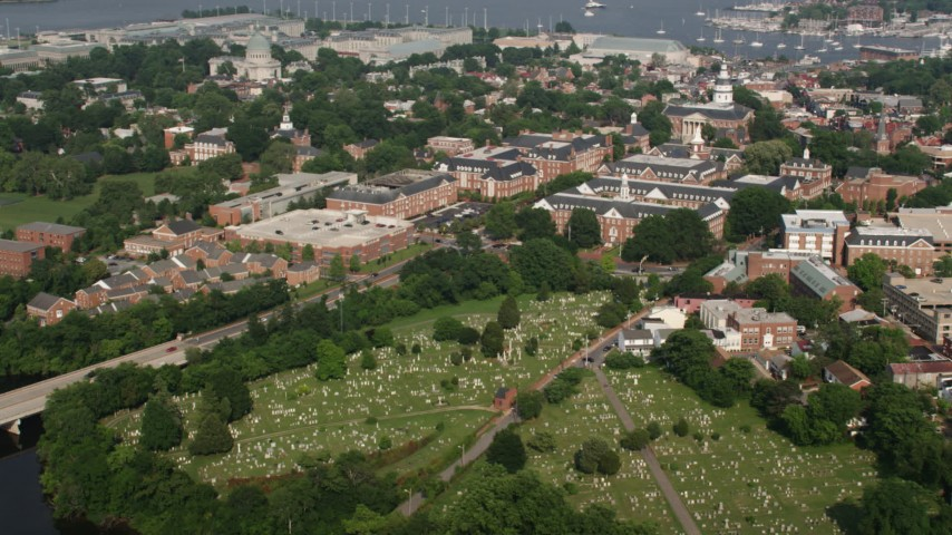 5K stock footage aerial video of St Annes Cemetery and Maryland State House in Annapolis Aerial Stock Footage | AX73_014