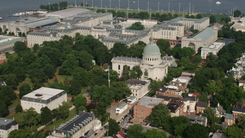 5K stock footage aerial video of The Chapel and Bancroft Hall at the United States Naval Academy in Annapolis, Maryland Aerial Stock Footage | AX73_016