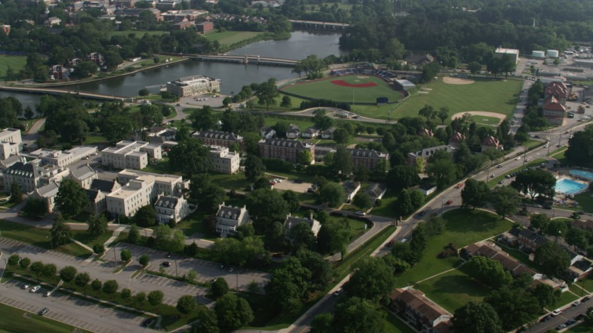 5K stock footage aerial video of campus buildings and Navy Baseball Stadium at United States Naval Academy, Annapolis, Maryland Aerial Stock Footage | AX73_020