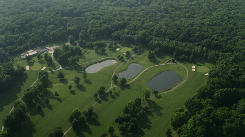 5K stock footage aerial video passing the Rocky Point Golf Course in Essex, Maryland Aerial Stock Footage | AX73_045