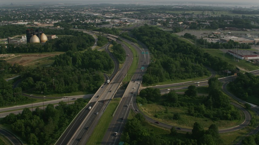5K stock footage aerial video of Interstate 695 crossing Eastern Boulevard near wastewater treatment plant in Baltimore, Maryland Aerial Stock Footage | AX73_057