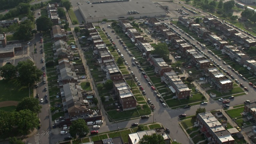 5K stock footage aerial video of a neighborhood with row houses in Baltimore, Maryland Aerial Stock Footage | AX73_058