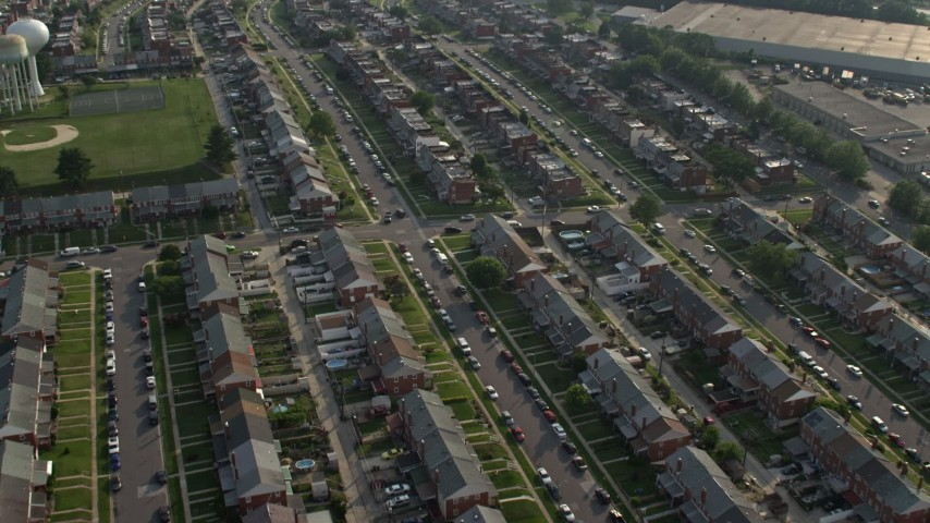 5K stock footage aerial video flying over a neighborhood of row houses in Baltimore, Maryland Aerial Stock Footage | AX73_059