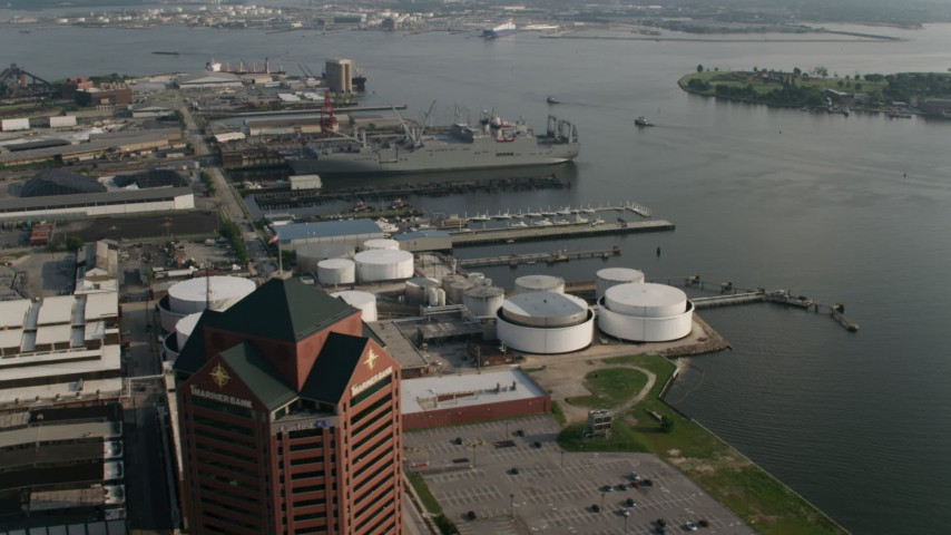 5K stock footage aerial video of Naval warships docked near oil tanks in Baltimore, Maryland Aerial Stock Footage | AX73_063