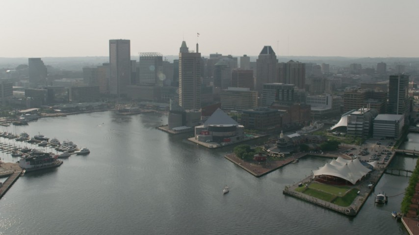 5K stock footage aerial video approaching Downtown Baltimore skyscrapers, National Aquarium, Harborplace pavilions, Maryland Aerial Stock Footage | AX73_068