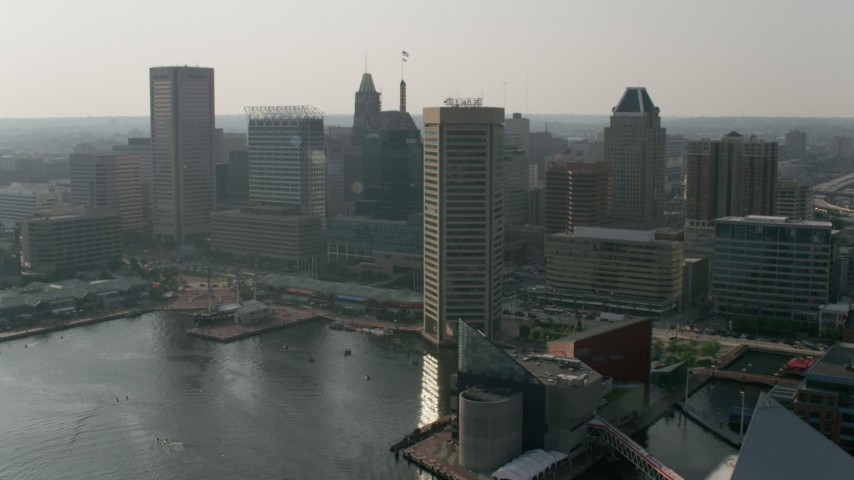 5K aerial video flying by Harborplace and Downtown Baltimore skyscrapers, Maryland Aerial Stock Footage | AX73_069