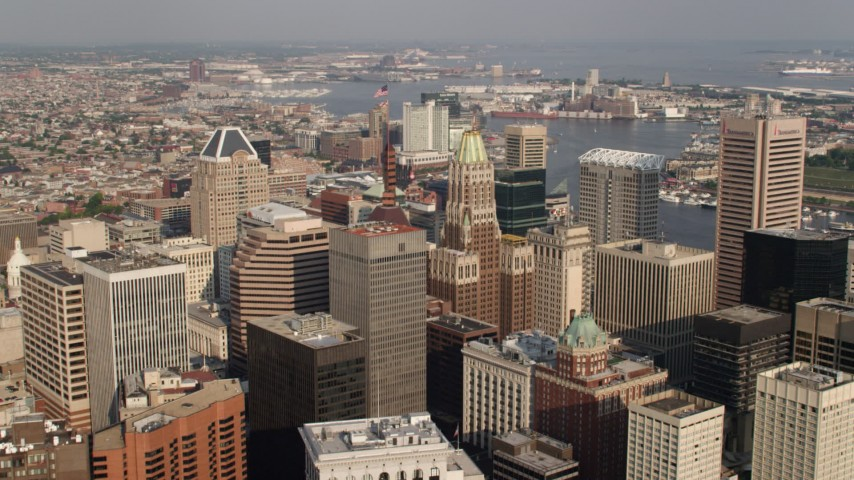 5K aerial video approaching Schaefer Tower and Bank of America Building in Downtown Baltimore, Maryland Aerial Stock Footage | AX73_077