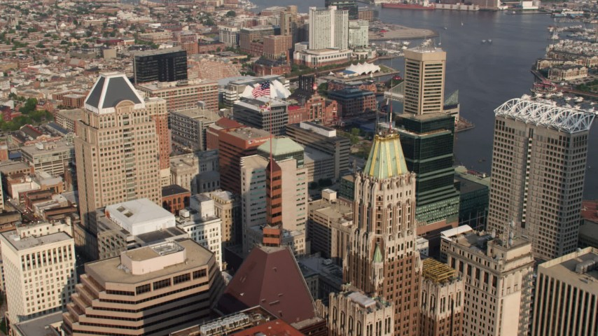 5K stock footage aerial video flying over skyscrapers to approach Pratt Street Power Plant in Downtown Baltimore, Maryland Aerial Stock Footage | AX73_078