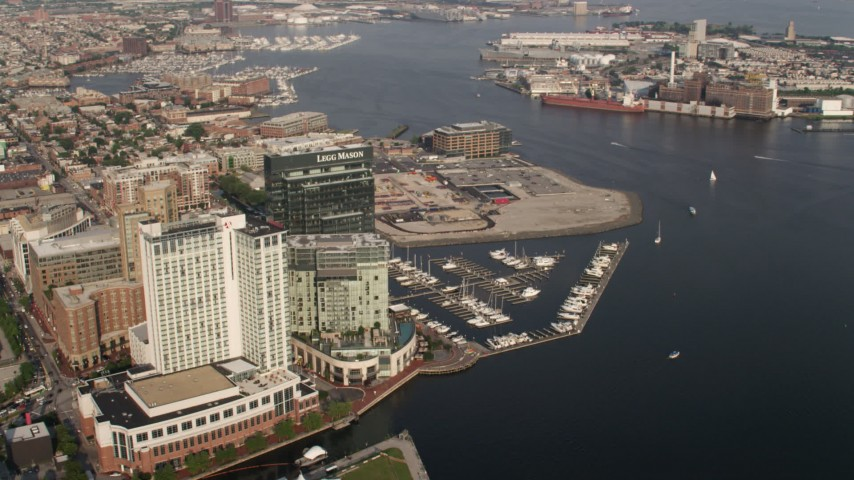 5K aerial video of Waterfront hotels, Legg Mason Tower, and Harbor East Marina in Downtown Baltimore, Maryland  Aerial Stock Footage | AX73_080