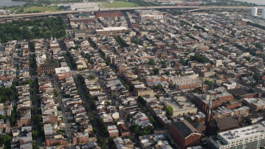 5K stock footage aerial video flying over urban town homes in Baltimore, Maryland Aerial Stock Footage | AX73_081