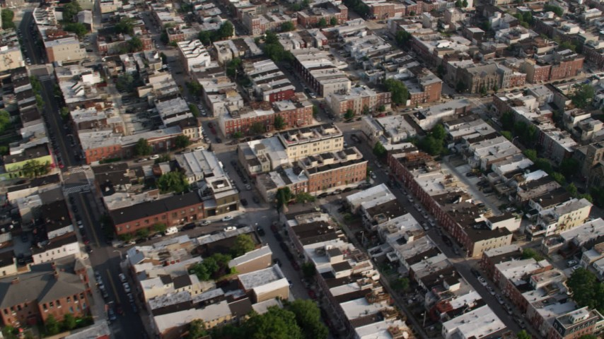5K aerial video flying over townhouses and apartment buildings in Baltimore, Maryland Aerial Stock Footage | AX73_082