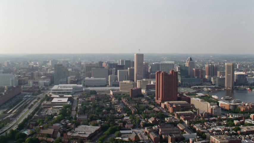 5K aerial video of the Baltimore Convention Center, Downtown Baltimore skyscrapers, and Towers at Harbor Court condo complex, Maryland Aerial Stock Footage | AX73_083