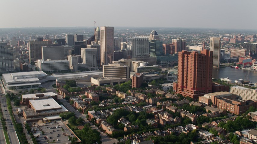 5K aerial video approaching Baltimore Convention Center, Transamerica Tower, and Towers at Harbor Court, Downtown Baltimore, Maryland Aerial Stock Footage | AX73_084