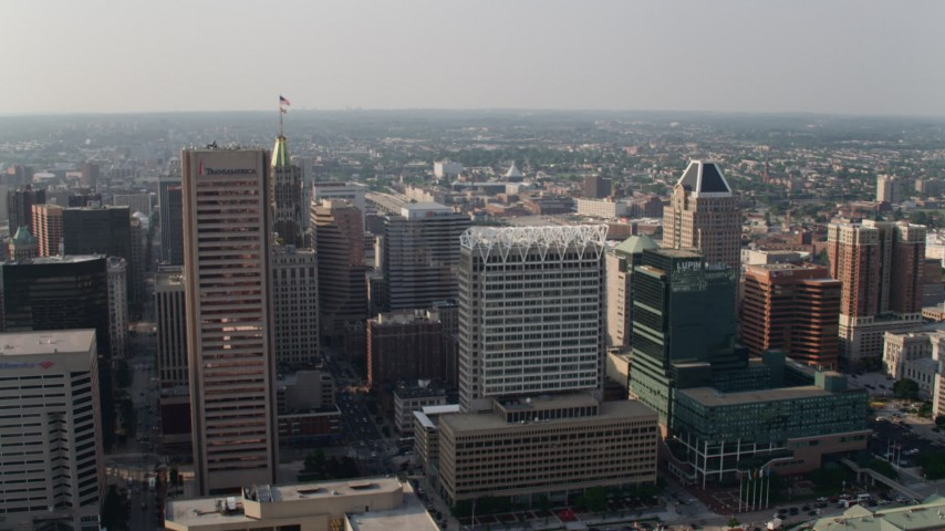 5K aerial video flying by Transamerica Tower, 100 East Pratt Street, and The Gallery Mall and office tower in Downtown Baltimore, Maryland Aerial Stock Footage | AX73_086