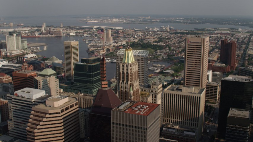 5K stock footage aerial video flying by Schaefer Tower, Bank of America Building, Transamerica Tower in Downtown Baltimore, Maryland Aerial Stock Footage | AX73_090