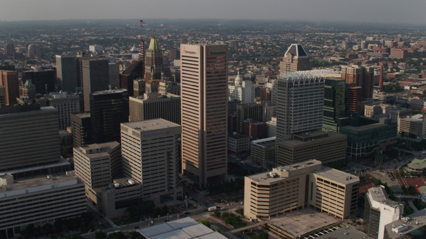 5K aerial video panning from Transamerica Tower and 100 East Pratt Street, to reveal National Aquarium, Downtown Baltimore, Maryland Aerial Stock Footage | AX73_093