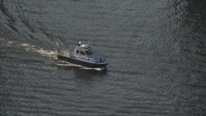 5K stock footage aerial video of a police boat on the Patapsco River in Baltimore, Maryland Aerial Stock Footage | AX73_094