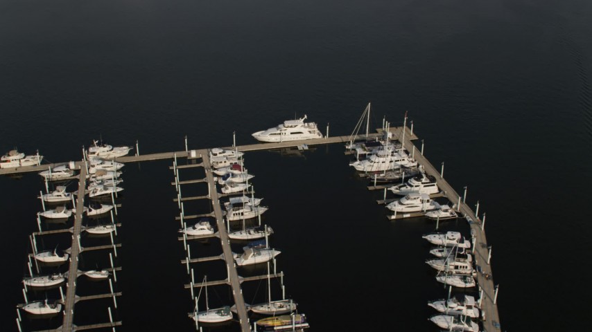 5K stock footage aerial video approaching a yacht docked at Baltimore Marine Center, Maryland Aerial Stock Footage | AX73_098
