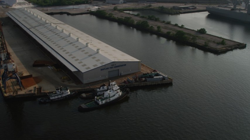 5K aerial video of Maryland Port Administration Pier and tugboats, Baltimore Aerial Stock Footage | AX73_099