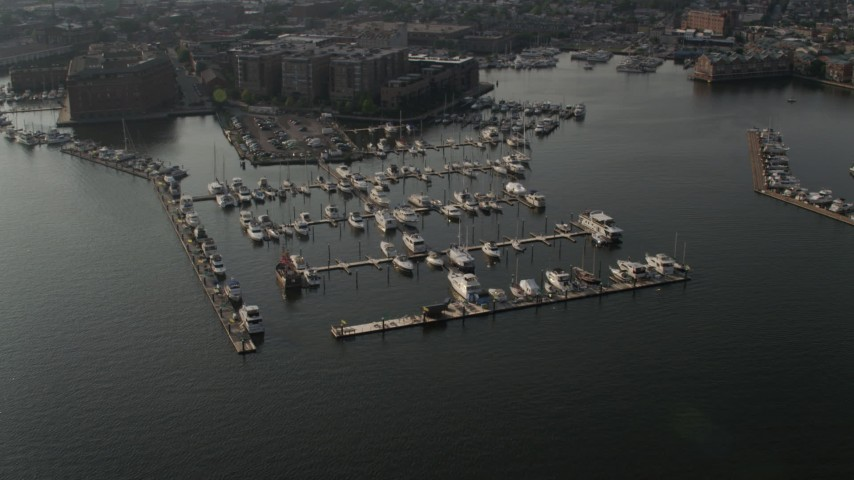 5K stock footage aerial video approaching Henderson's Wharf Marina on the Patapsco River in Baltimore, Maryland Aerial Stock Footage | AX73_100