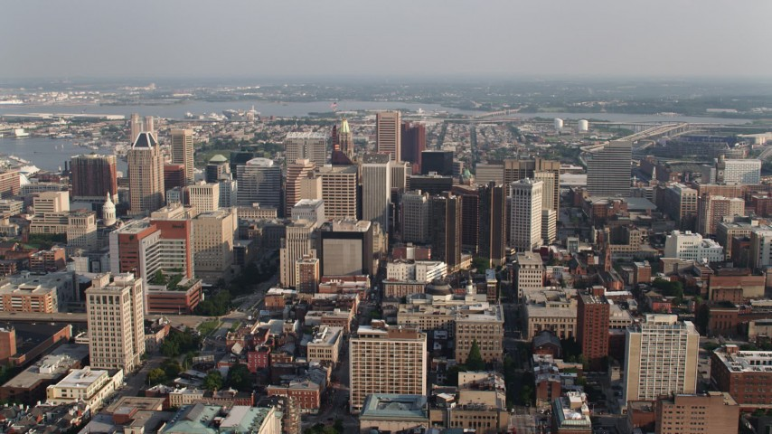 5K aerial video flying by tall skyscrapers in Downtown Baltimore, Maryland Aerial Stock Footage | AX73_106