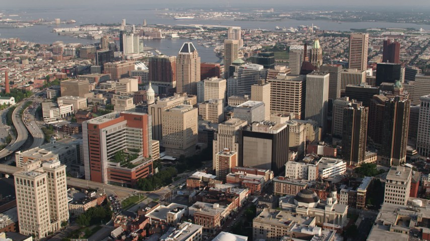 5K aerial video approaching Baltimore City Hall and skyscrapers in downtown, Maryland Aerial Stock Footage | AX73_107