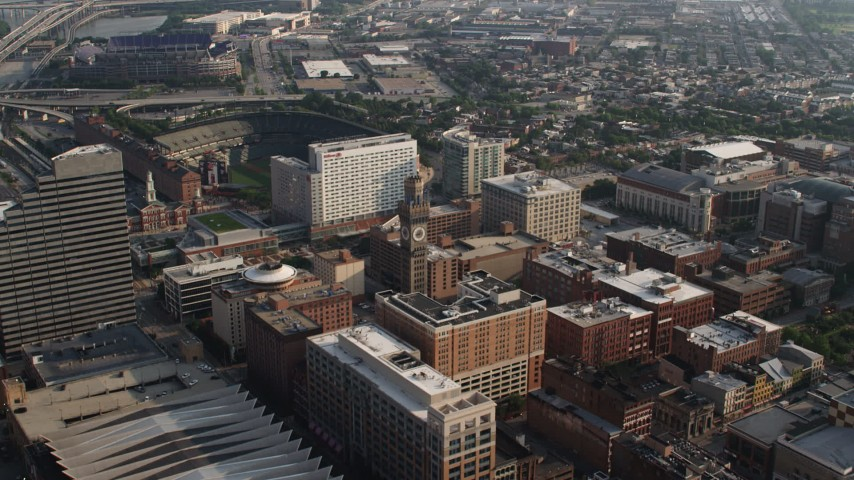 5K aerial video approaching Emerson Bromo-Seltzer Tower, Baltimore Hilton, and Oriole Park in Downtown Baltimore, Maryland Aerial Stock Footage | AX73_109