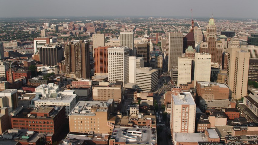5K aerial video passing by Downtown Baltimore's skyscrapers, Maryland Aerial Stock Footage | AX73_118