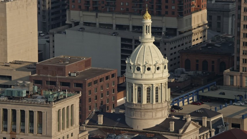 5K stock footage aerial video of the Baltimore City Hall dome in Downtown Baltimore, Maryland Aerial Stock Footage | AX73_119