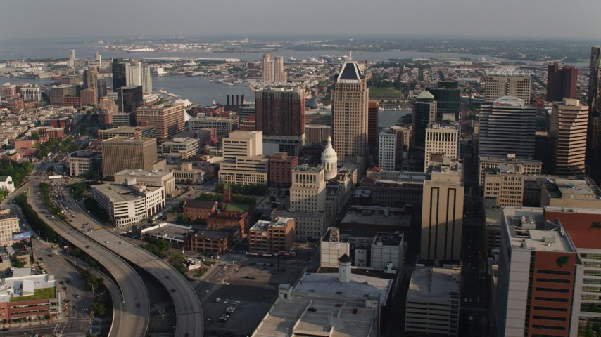5K stock footage aerial video of Baltimore City Hall and surrounding skyscrapers in Downtown Baltimore, Maryland Aerial Stock Footage | AX73_120