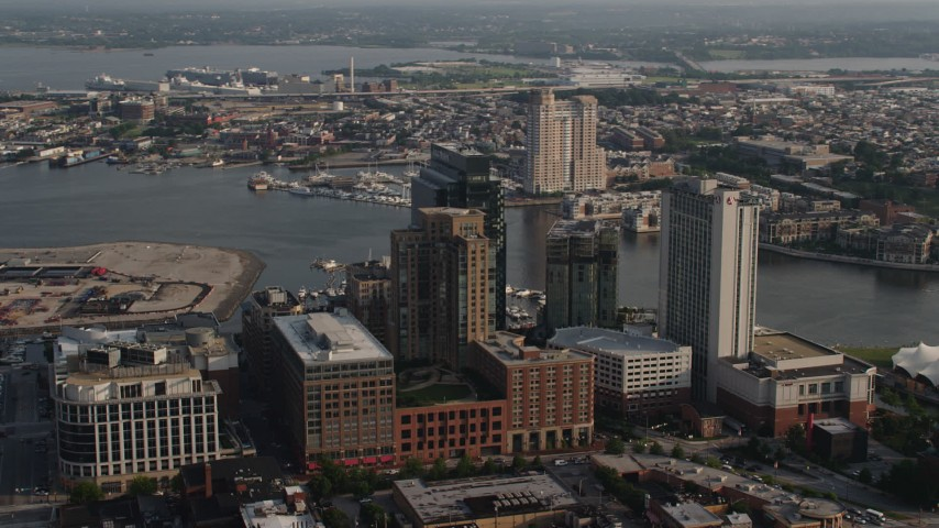 5K aerial video of riverfront hotels, Legg Mason Tower, and office buildings in Downtown Baltimore, Maryland Aerial Stock Footage | AX73_122