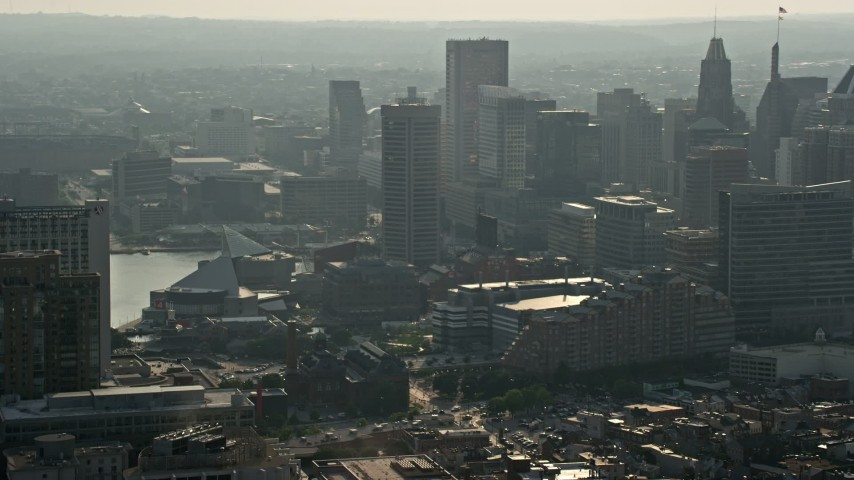 5K stock footage aerial video of a reverse view of Downtown Baltimore skyscrapers, Maryland Aerial Stock Footage | AX73_123