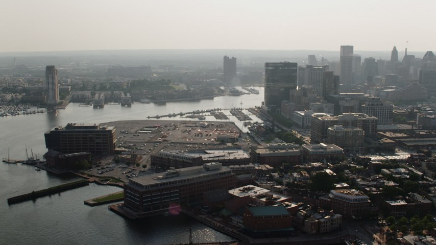 5K aerial video of Downtown Baltimore skyscrapers and office buildings by the Patapsco River, Maryland Aerial Stock Footage | AX73_124