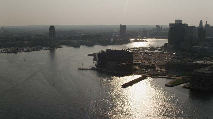 5K aerial video of office building on by Patapsco River near Downtown Baltimore skyscrapers, Maryland Aerial Stock Footage | AX73_125