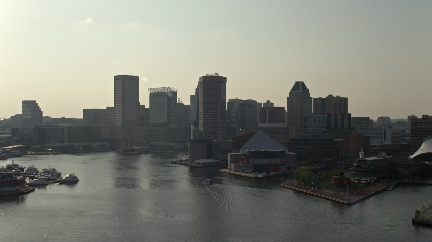 5K stock footage aerial video flying low toward Inner Harbor and National Aquarium in Downtown Baltimore, Maryland Aerial Stock Footage | AX73_128E