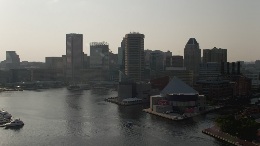 5K aerial video flying by National Aquarium to approach World Trade Center and skyscrapers, Downtown Baltimore, Maryland Aerial Stock Footage | AX73_129