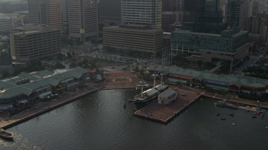 5K stock footage aerial video of USS Constellation and the Pratt Street Pavilion in Downtown Baltimore, Maryland Aerial Stock Footage | AX73_130