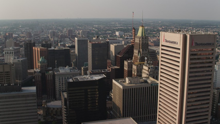 5K aerial video of Schaefer Tower and the Bank of America Building in Downtown Baltimore, Maryland Aerial Stock Footage | AX73_131