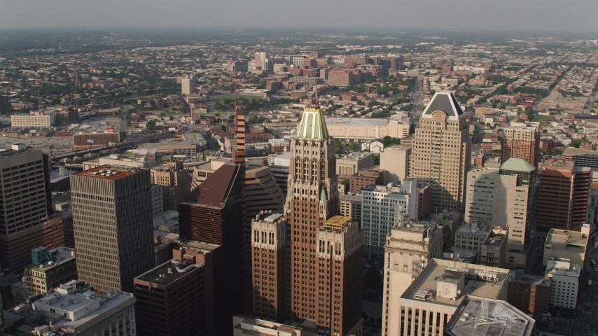 5K aerial video passing Schaefer Tower and the Bank of America Building, Downtown Baltimore, Maryland Aerial Stock Footage | AX73_132