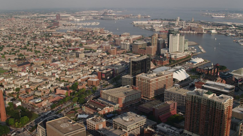 5K aerial video of Baltimore Marriott Waterfront Hotel and office buildings by Patapsco River, Downtown Baltimore, Maryland Aerial Stock Footage | AX73_134