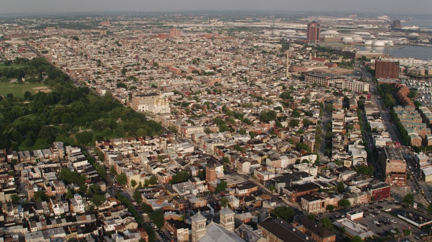 5K stock footage aerial video of apartment buildings, townhouses, and St. Michael's Ukrainian Church in Baltimore, Maryland Aerial Stock Footage | AX73_136