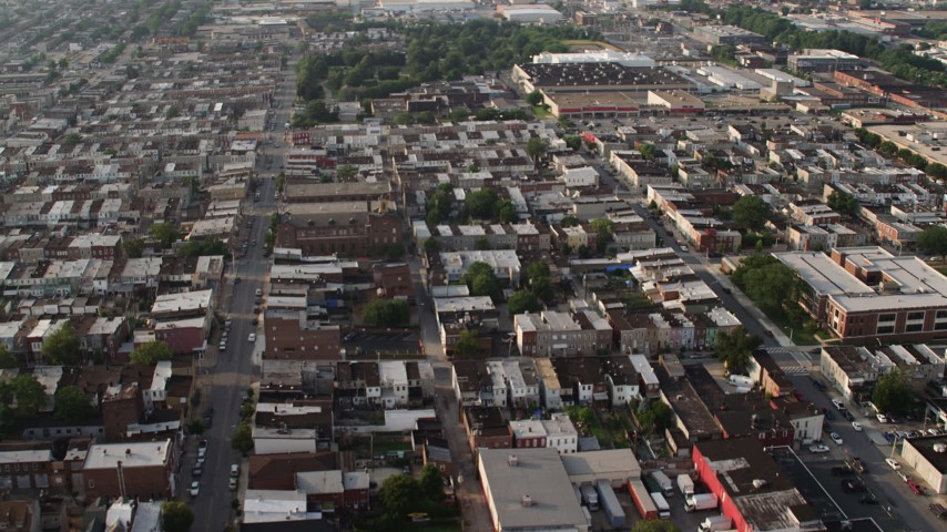 5K stock footage aerial video of urban town homes and Our Lady of Pompeii Church in Baltimore, Maryland Aerial Stock Footage | AX73_139