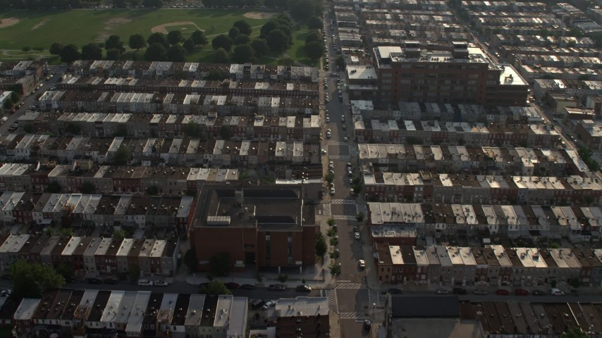 5K stock footage aerial video of urban row houses, streets, and Highlandtown Elementary School in Baltimore, Maryland Aerial Stock Footage | AX73_140